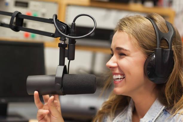 laughing pretty radio host moderating - talk in a radio foto e immagini stock