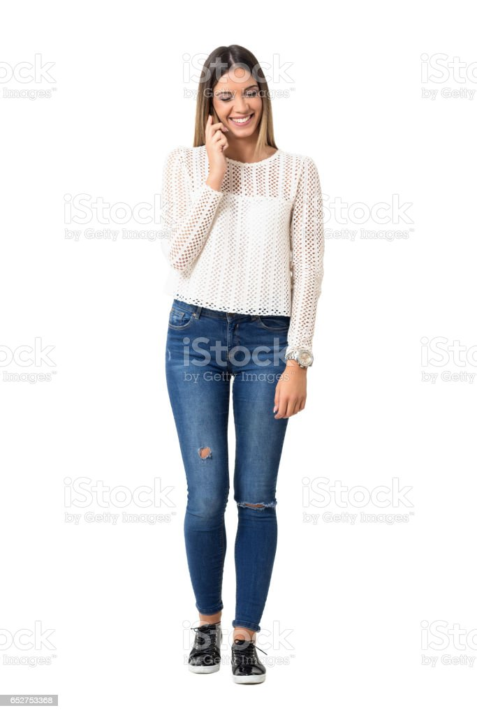 Laughing relaxed young casual woman on the phone with closed eyes stock photo