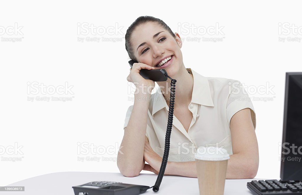 Laughing secretary answering the phone royalty-free stock photo