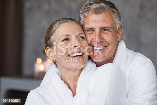 istock Laughing senior couple embracing at spa 994810662