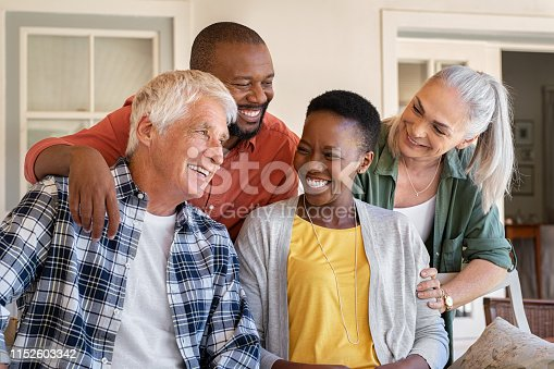 istock Laughing senior friends with happy women 1152603342