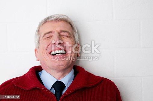 istock laughing senior man 174649265
