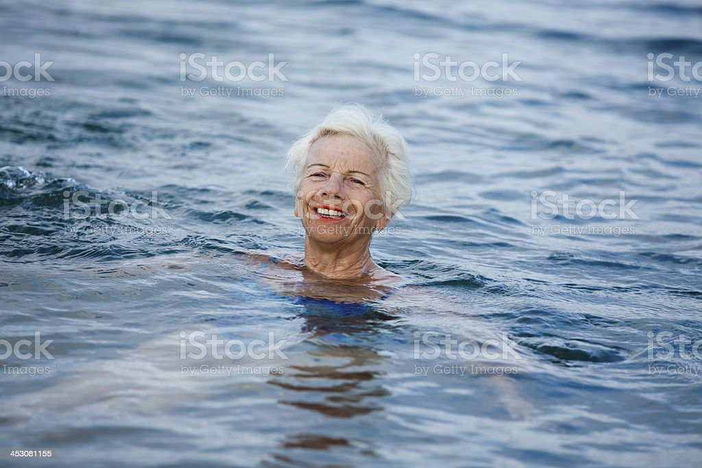 Laughing Senior Woman Relaxing In The Sea royalty-free stock photo