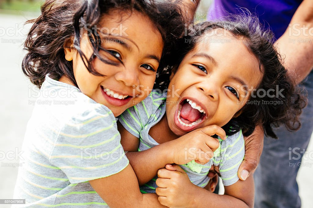 Laughing sisters stock photo