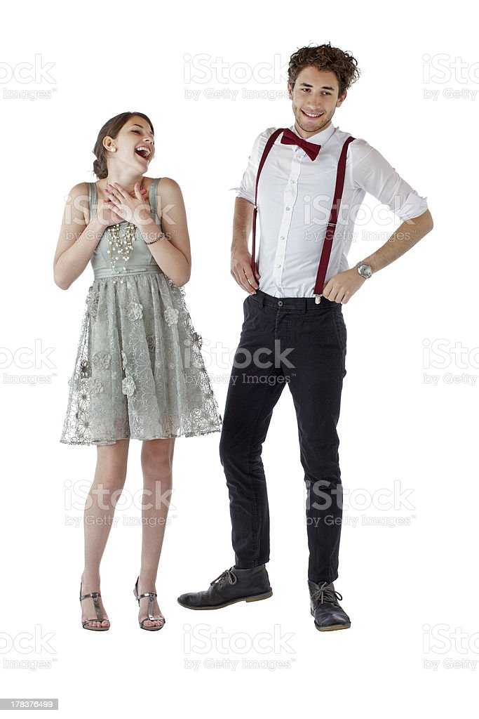 Laughing teen couple dressed up in prom clothes royalty-free stock photo
