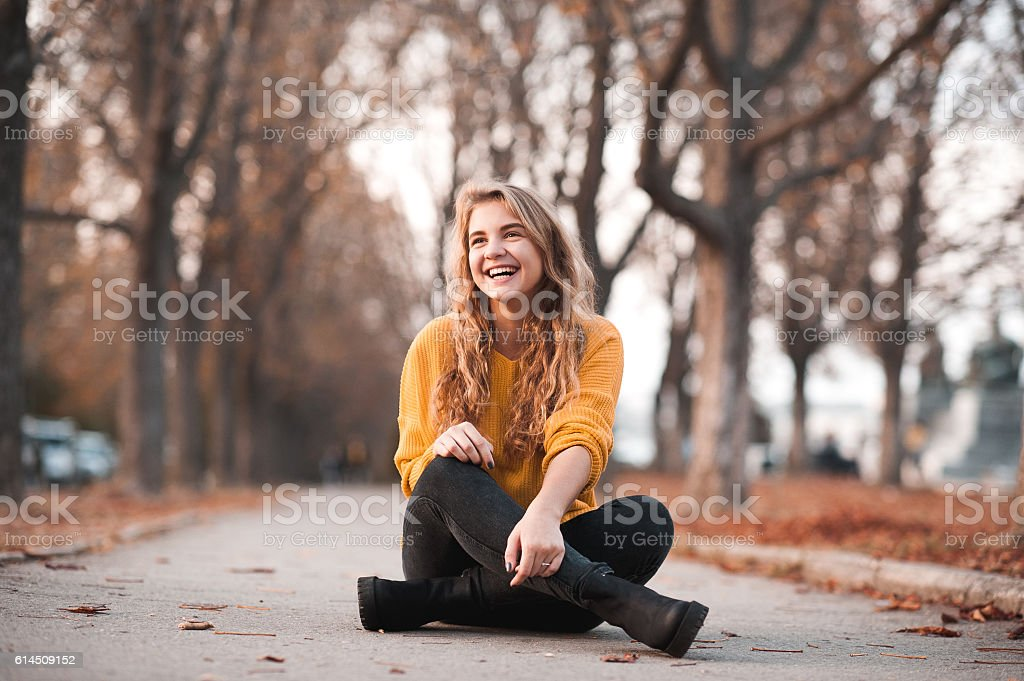 Laughing teenager girl outdoors stock photo