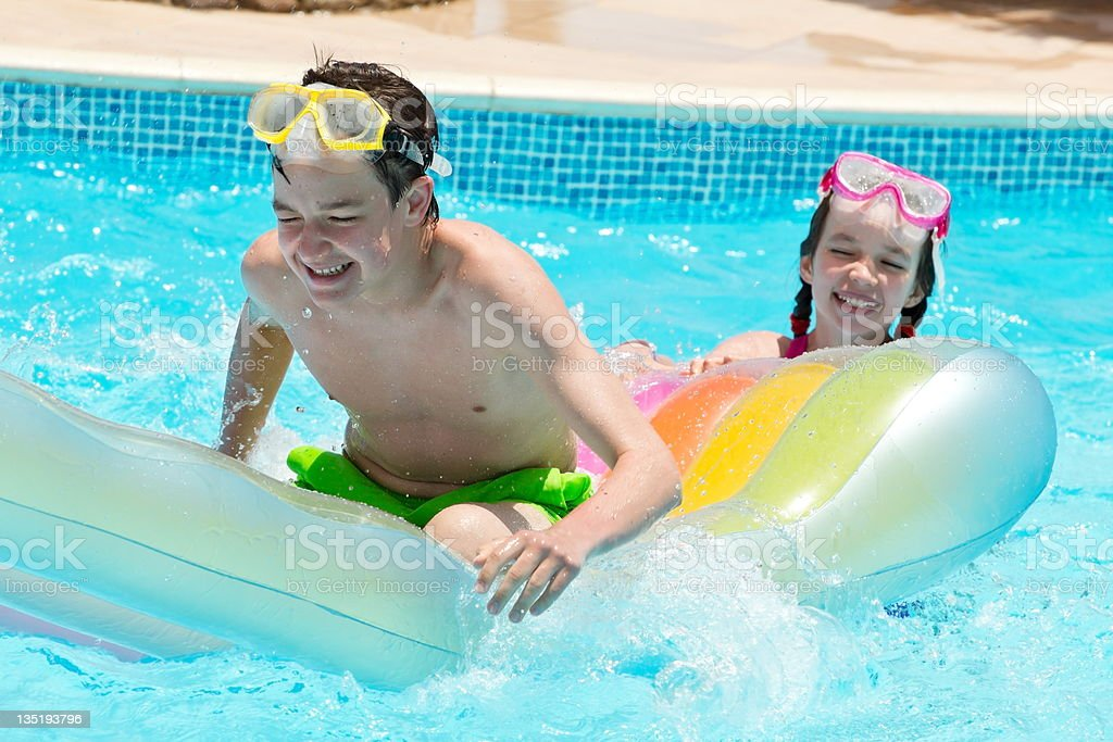 Laughing teens in Pool royalty-free stock photo
