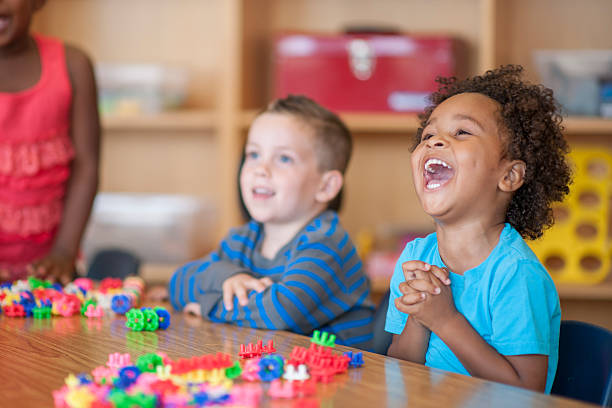 laughing together in class - preschool building stock photos and pictures