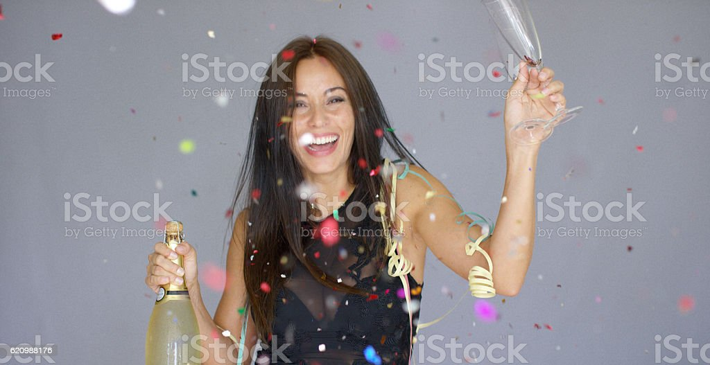 Laughing vivacious woman celebrating the New year foto royalty-free