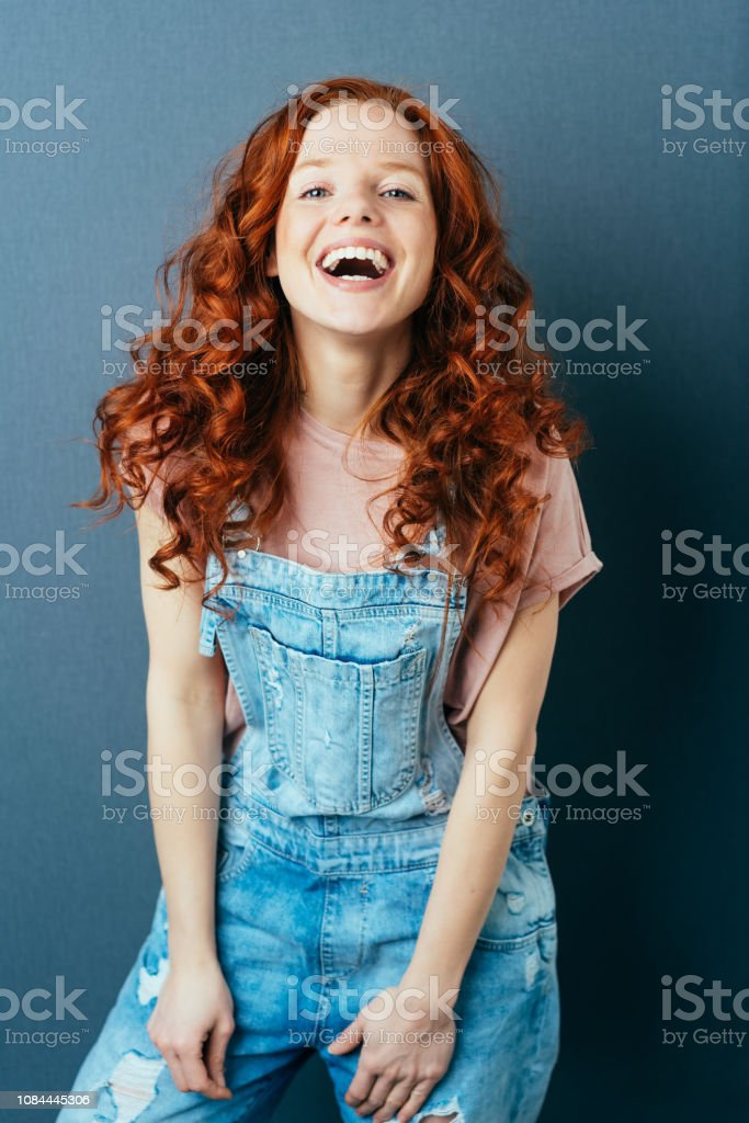 Laughing vivacious woman with a sense of humor wearing trendy...