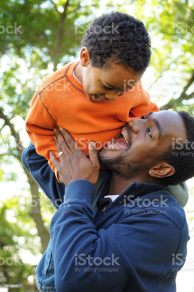 Laughing with Daddy! stock photo