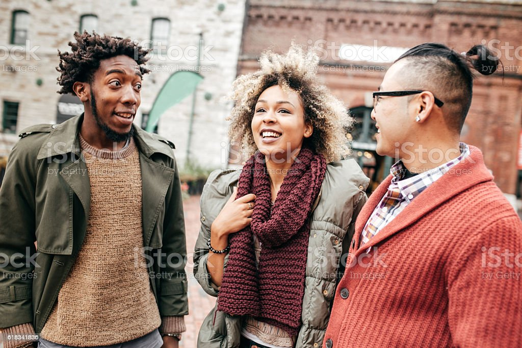 Laughing with friends stock photo