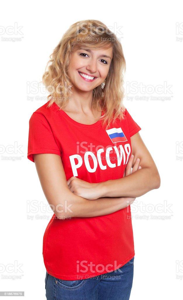 Rindo mulher da Rússia com braços cruzados - foto de acervo