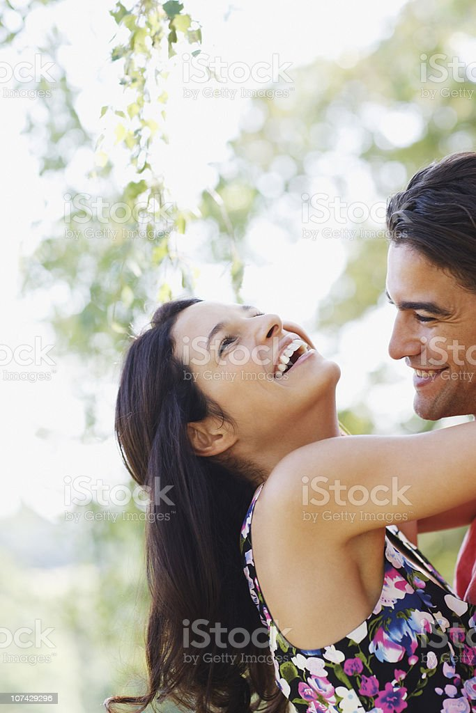 Laughing woman hugging husband outdoors royalty-free stock photo
