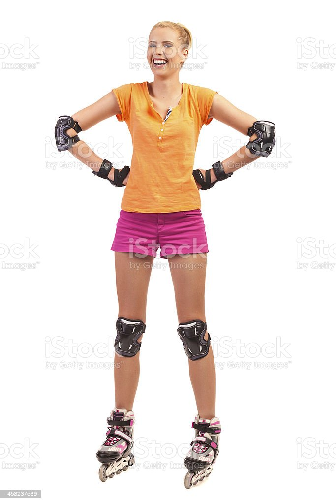 Laughing Woman on rollerblades. stock photo