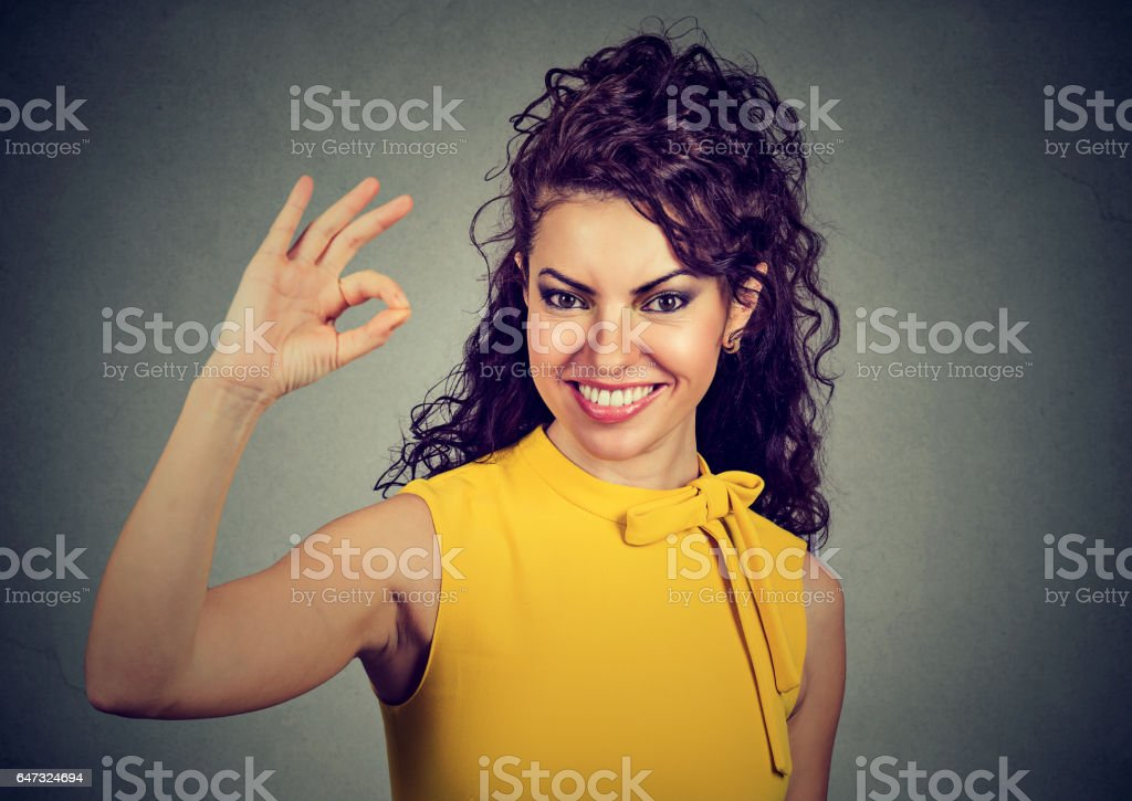 Laughing woman showing ok sign stock photo