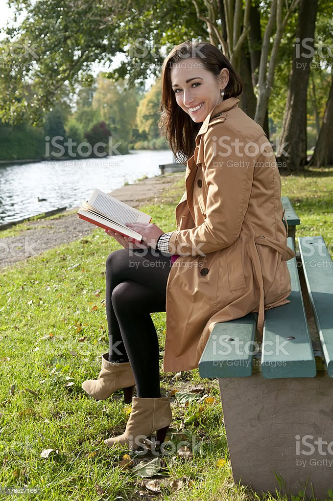 laughing woman with book royalty-free stock photo