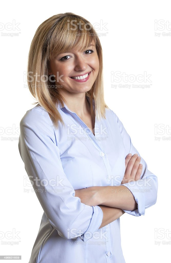 Laughing woman with crossed arms and dark eyes stock photo