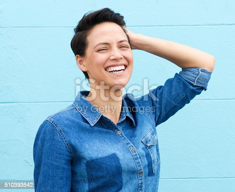 istock Laughing woman with hand in hair 510393542