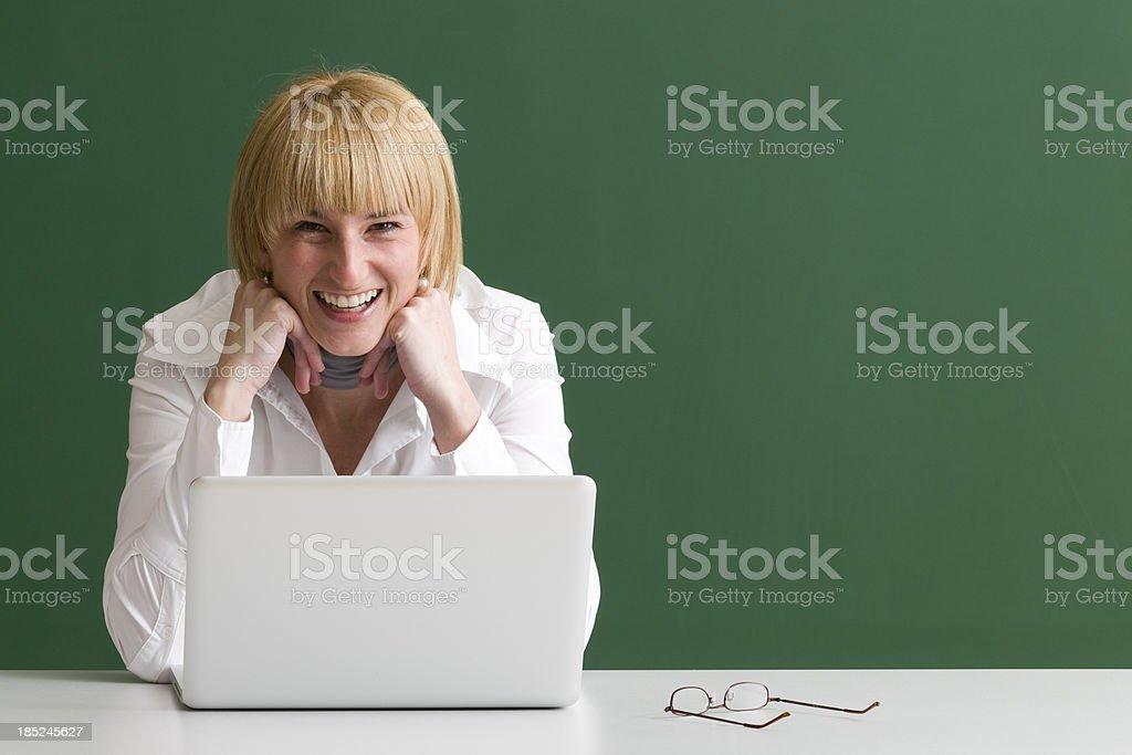 laughing woman working at laptop stock photo