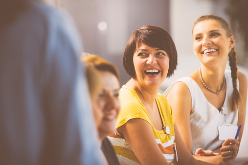 Laughing Women On Seminar Stock Photo - Download Image Now