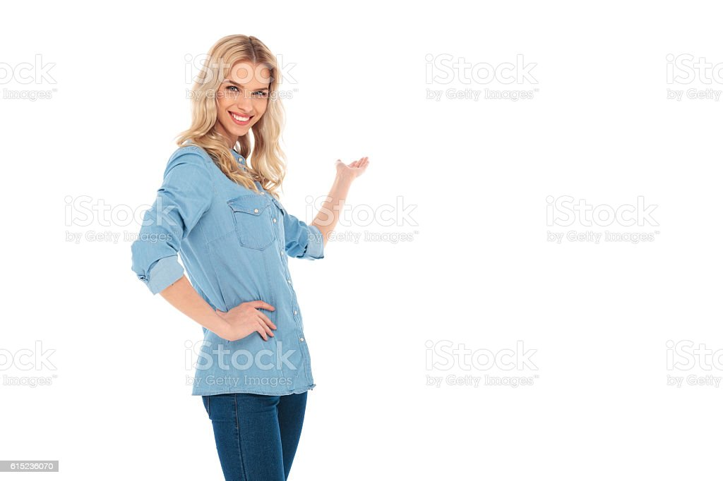 laughing young blonde woman presenting stock photo