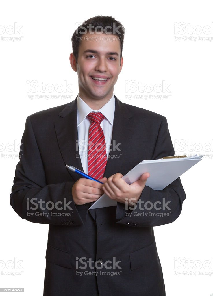 Laughing young businessman with clipboard stock photo