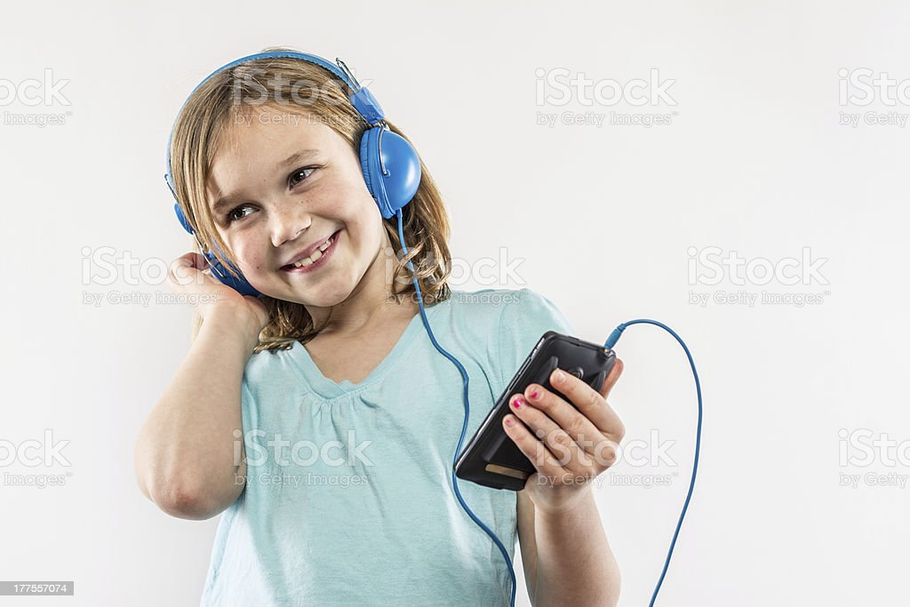 Laughing Young Girl Listening To Music On Retro Headphones