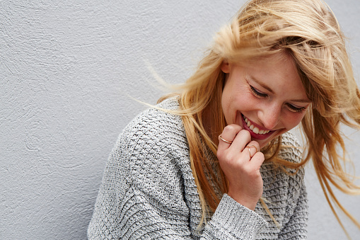 istock Laughing young lady 878909000