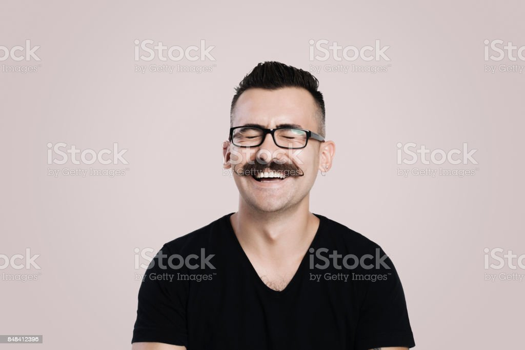 Laughing young man with mustache stock photo