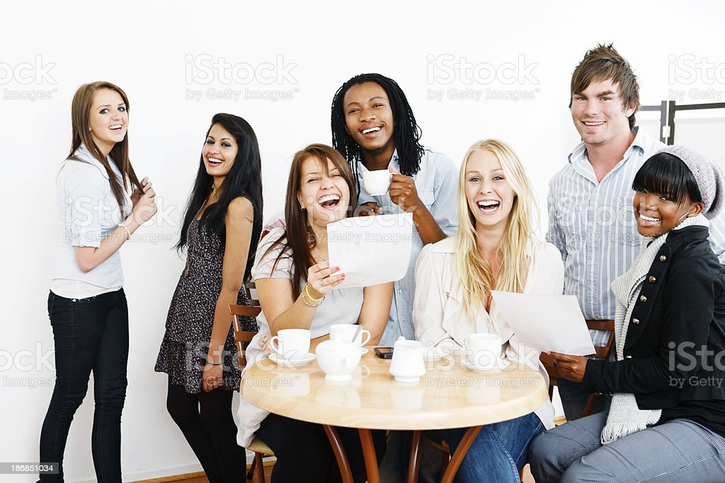 Laughing young people with documents in coffeeshop - good news! royalty-free stock photo