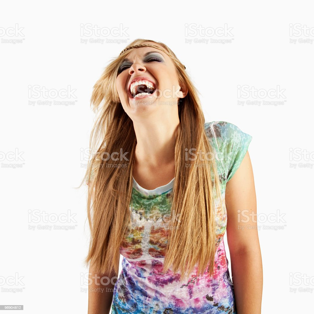 Laughing Young Woman in 1960's Tie-Dye Outfit royalty-free stock photo