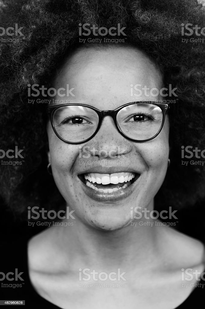 Laughing young woman in black and white image stock photo