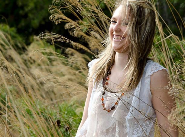 junge frau lachen - rüschenbluse stock-fotos und bilder