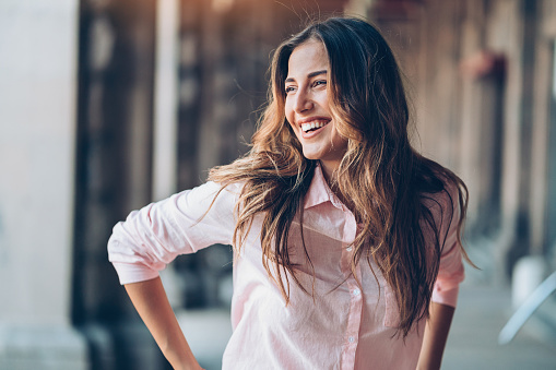 Portrait of a beautiful young laughing woman