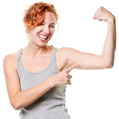 657442382 istock photo Laughing Young Woman Shows Arm Muscle 183293238