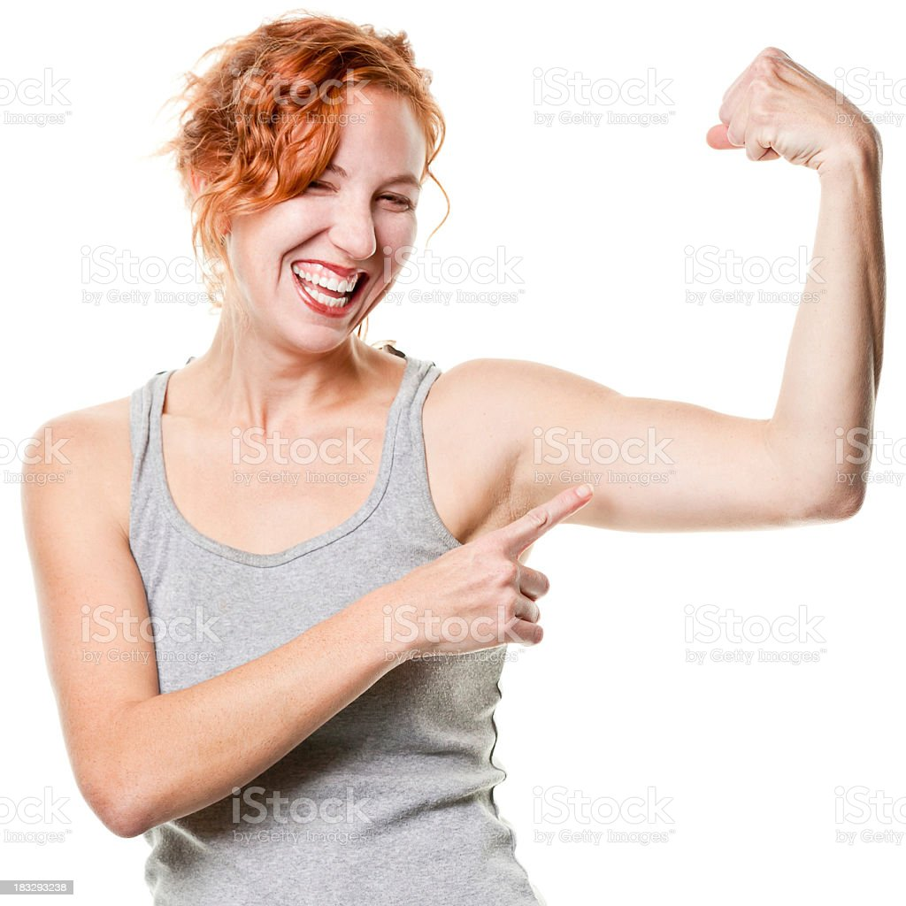 Laughing Young Woman Shows Arm Muscle stock photo