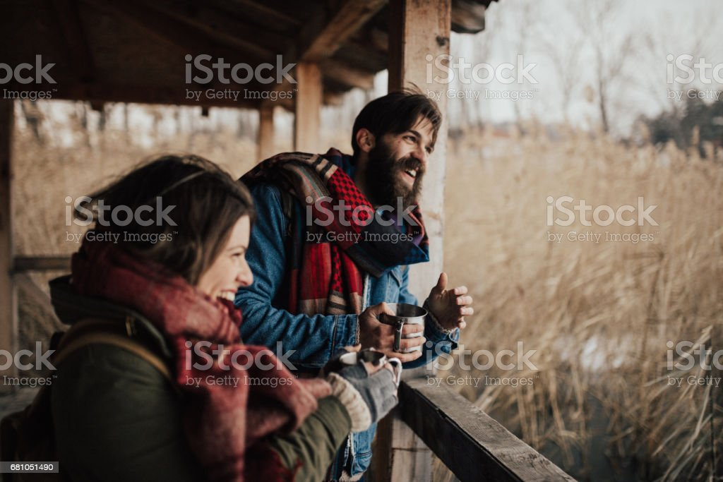 Laughter and hot drinks will beat the cold stock photo