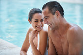 Cropped shot of a loving mature couple relaxing in a pool