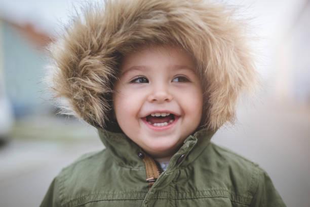 kahkaha bir çocuğun - baby teeth stok fotoğraflar ve resimler