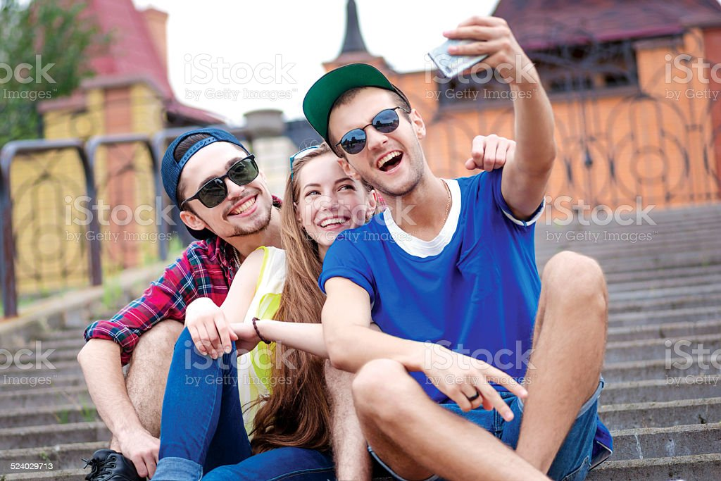 Laughter of friends. Young friends have fun together stock photo