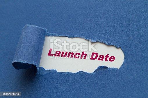 Launch Date written under torn paper.
