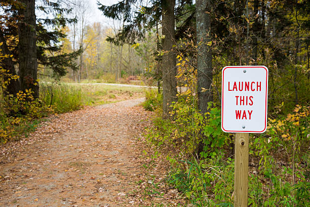 Launch Sign Next to Winding Path stock photo