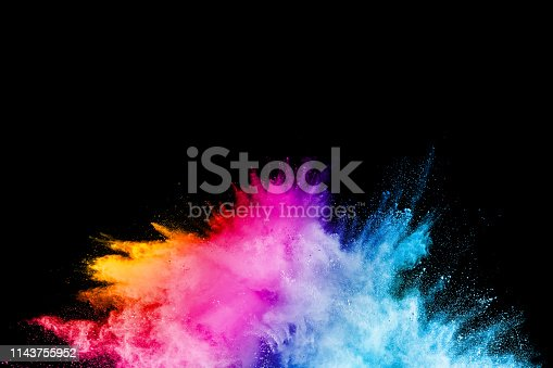 874001870 istock photo Launched colorful powder on black background.Color powder explosion.Colorful dust splashing. 1143755952