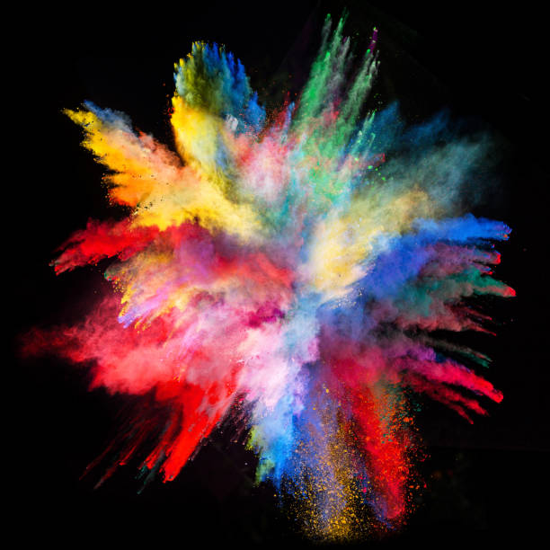 Launched colorful powder Explosion of colorful powder, isolated on black background explosive stock pictures, royalty-free photos & images