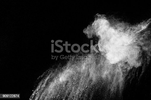 874895414 istock photo Launched white particle splash on black background. Bizarre forms of of white powder explosion cloud against dark background. 909122674
