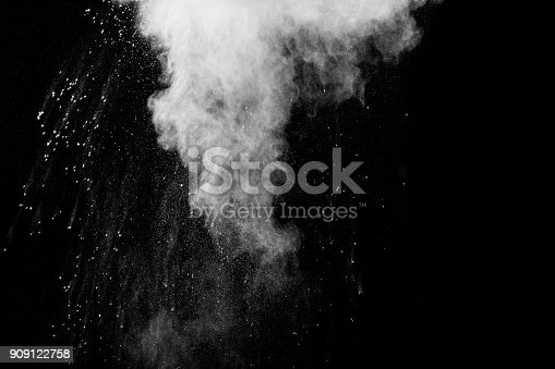 909122710 istock photo Launched white particle splash on black background. Bizarre forms of of white powder explosion cloud against dark background. 909122758