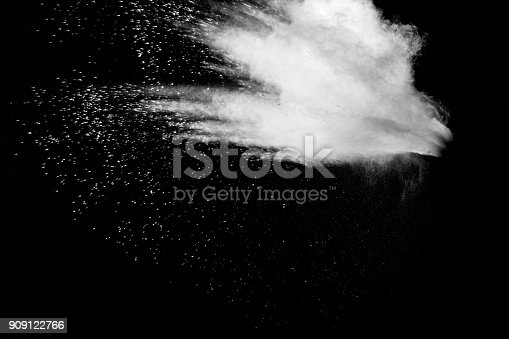 909122710 istock photo Launched white particle splash on black background. Bizarre forms of of white powder explosion cloud against dark background. 909122766