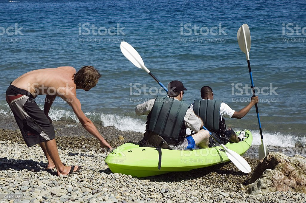 Launching a Kayak royalty-free stock photo