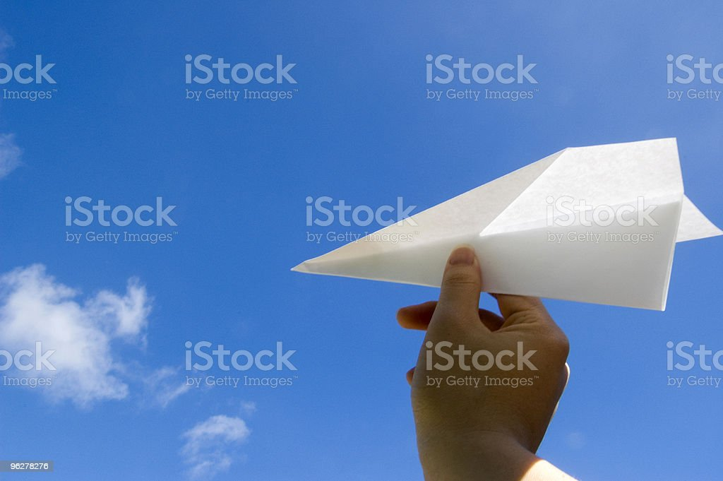 Launching a paper airplane royalty-free stock photo